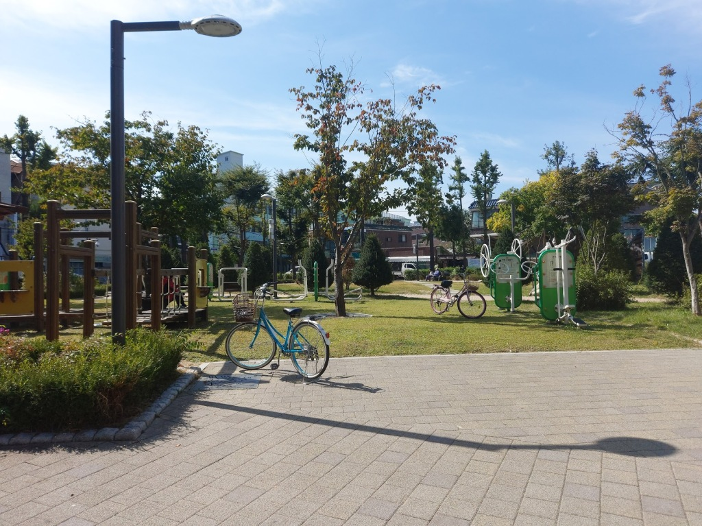 Another view of the park across the street, where you can see bicycles and outdoor exercising equipment