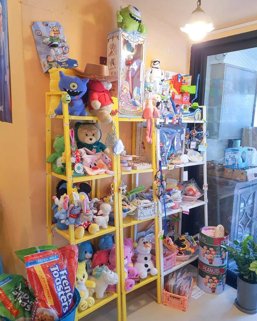 A close-up of some of the shelves with toys and stuffed animals